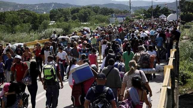 Migrantes venezuelanos, em foto de maio de 2018; plano de Guaidó prevê retorno deles para a 'reconstrução da Venezuela'