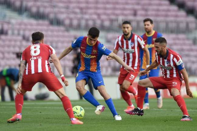 Barça e Atlético fizeram um duelo com vontade, mas sem inspiração (JOSEP LAGO / AFP)