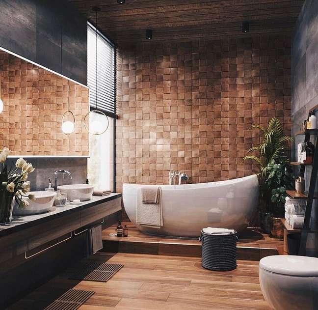19. Banheiro grande moderno decorado com revestimento amadeirado 3D e cuba redonda – Foto: UltraLinx