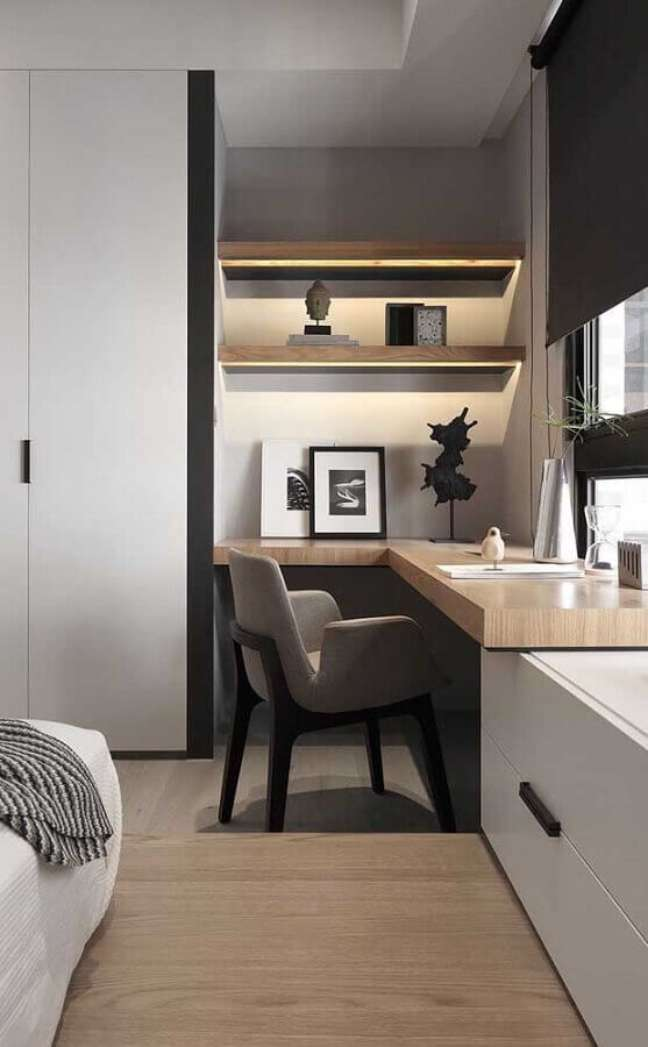 40. Escrivaninha de canto para decoração de quarto planejado com escritório – Foto: Futurist Architecture