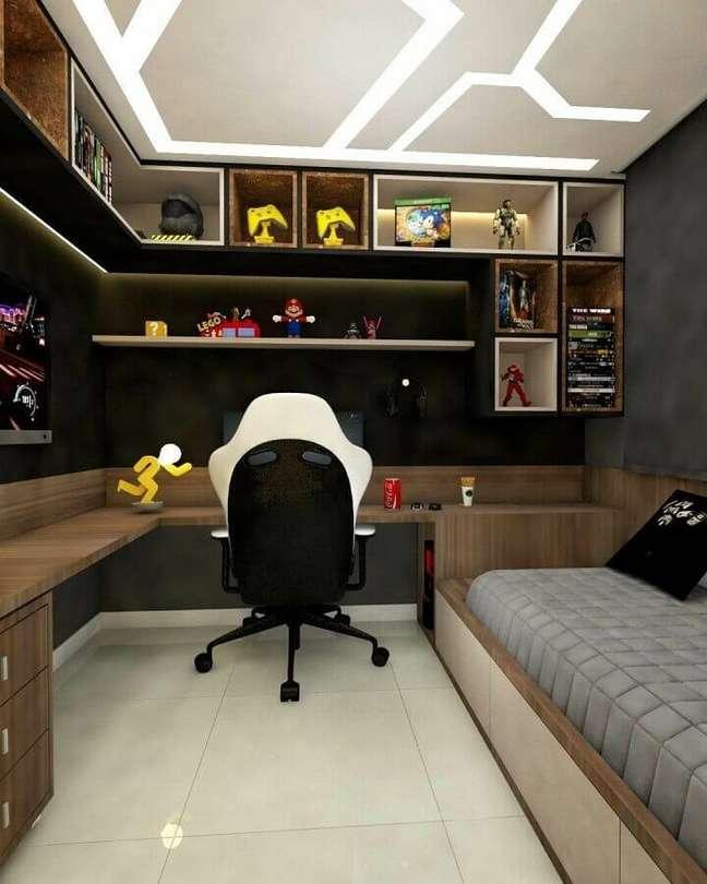 11. Bancada de madeira de canto para decoração de quarto planejado com escritório – Foto: Arkpad