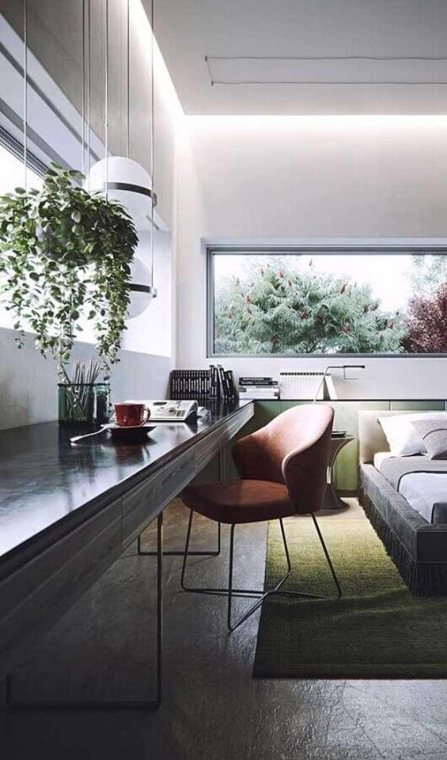 15. Bancada suspensa planejada para decoração moderna de quarto com escritório – Foto: Futurist Architecture