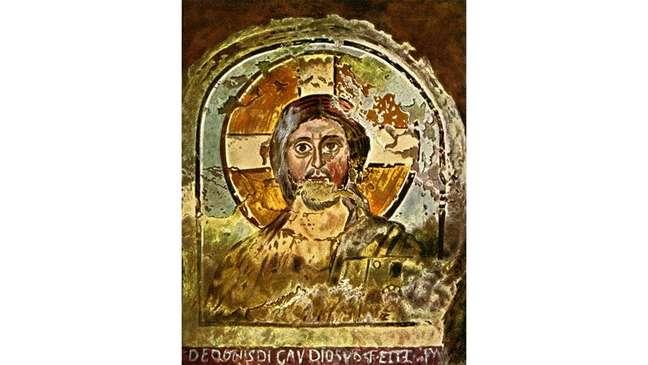 Jesus, às vezes, é representado com uma auréola cruciforme, como neste antigo afresco cristão nas catacumbas de Ponzianus, em Roma