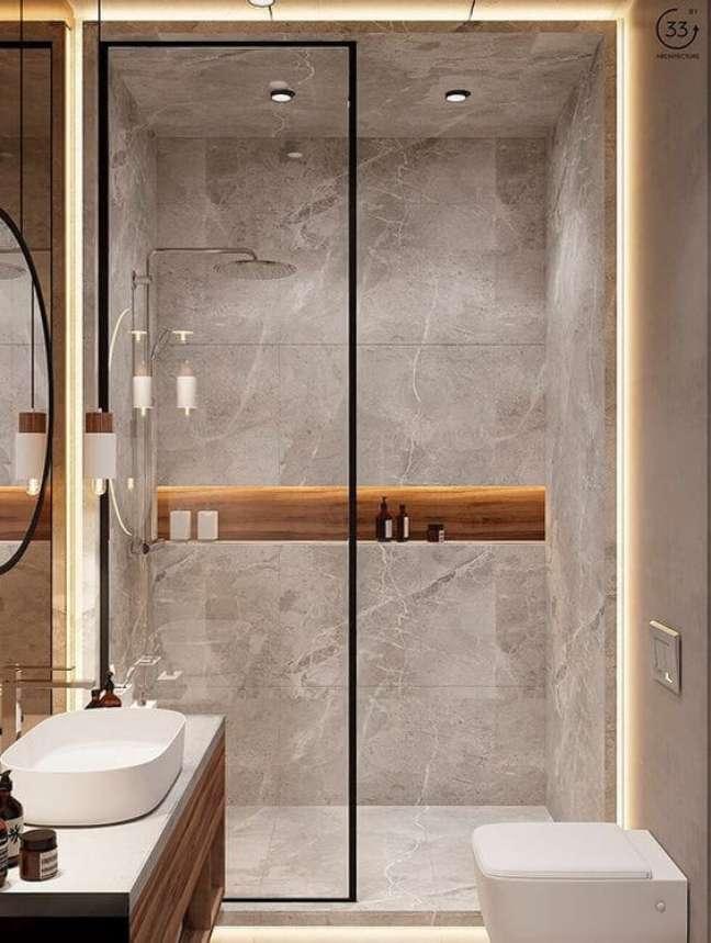 52. Banheiro sem janela com nicho de embutir com revestimento de madeira – Foto Fashion Bubbles