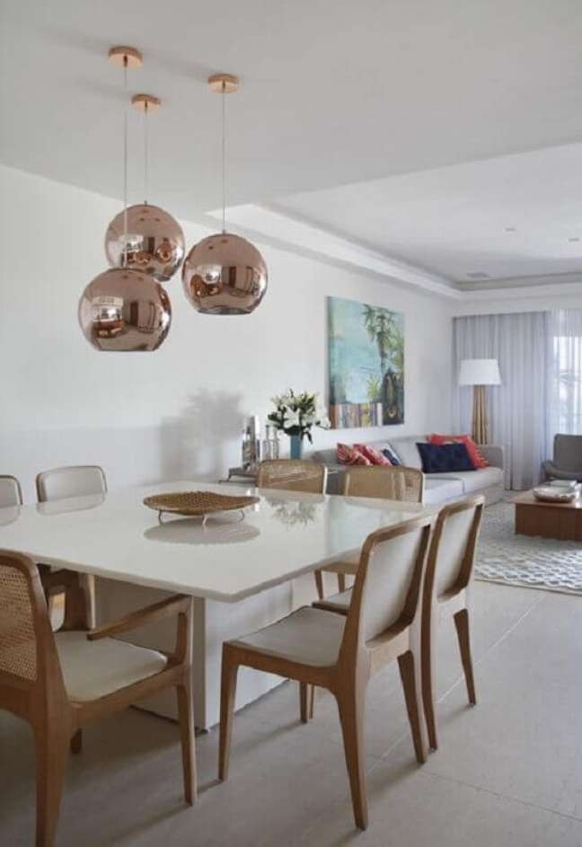 11. Decoração com luminárias para sala de estar e jantar conjugadas – Foto: Paula Neder