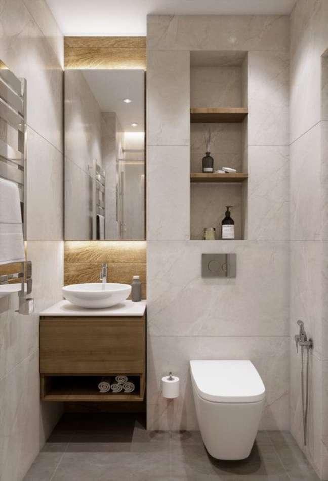 5. Nicho de embutir para banheiro com revestimento amadeirado e branco -Foto Architects