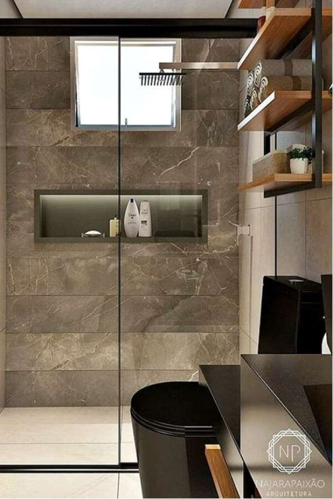 16. Nicho de embutir para banheiro com revestimento marmorizado marrom – Foto Simples Decoração