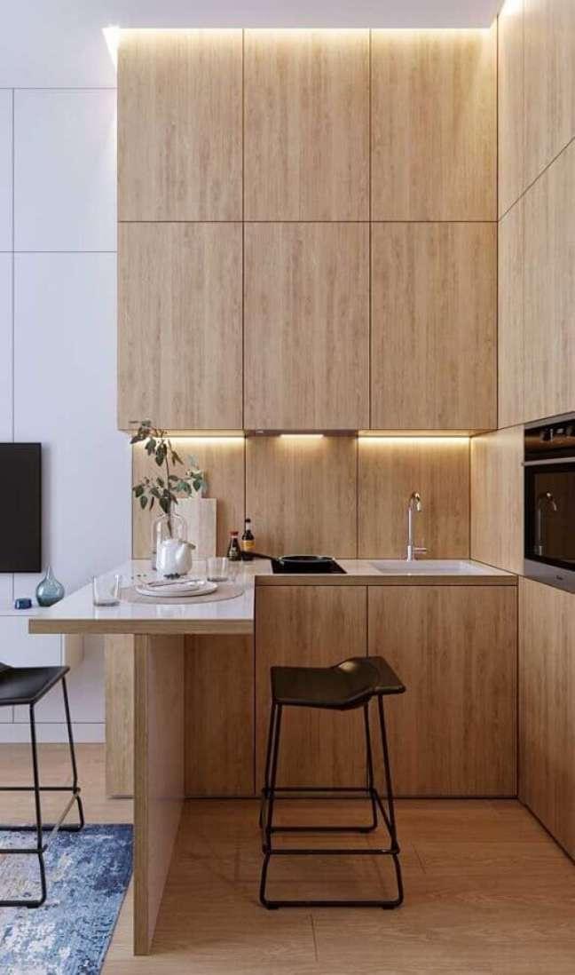 58. Móveis planejados para decoração de cozinha estilo americana pequena amadeirada – Foto: Apartment Therapy