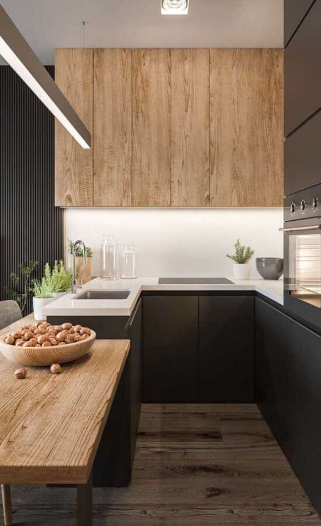 48. Decoração moderna com móveis planejados para cozinha estilo americana cinza com madeira – Foto: Futurist Architecture