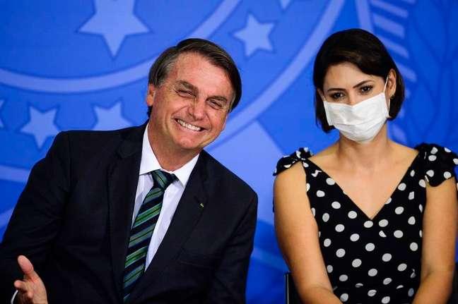 O presidente Jair Bolsonaro e a primeira-dama, Michelle, em eventono Palácio do Planalto.