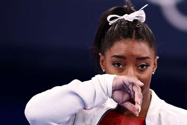 (FILES) In this file photo taken on July 27, 2021 USA's Simone Biles gestures during the artistic gymnastics women's team final during the Tokyo 2020 Olympic Games at the Ariake Gymnastics Centre in Tokyo. - Simone Biles withdrew from Olympics all-around gymnastics on July 28, 2021. (Photo by Loic VENANCE / AFP)