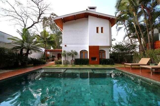 20. Casa de campo com piscina verde grande e funda. Projeto de MeyerCortez Arquitetura & Design