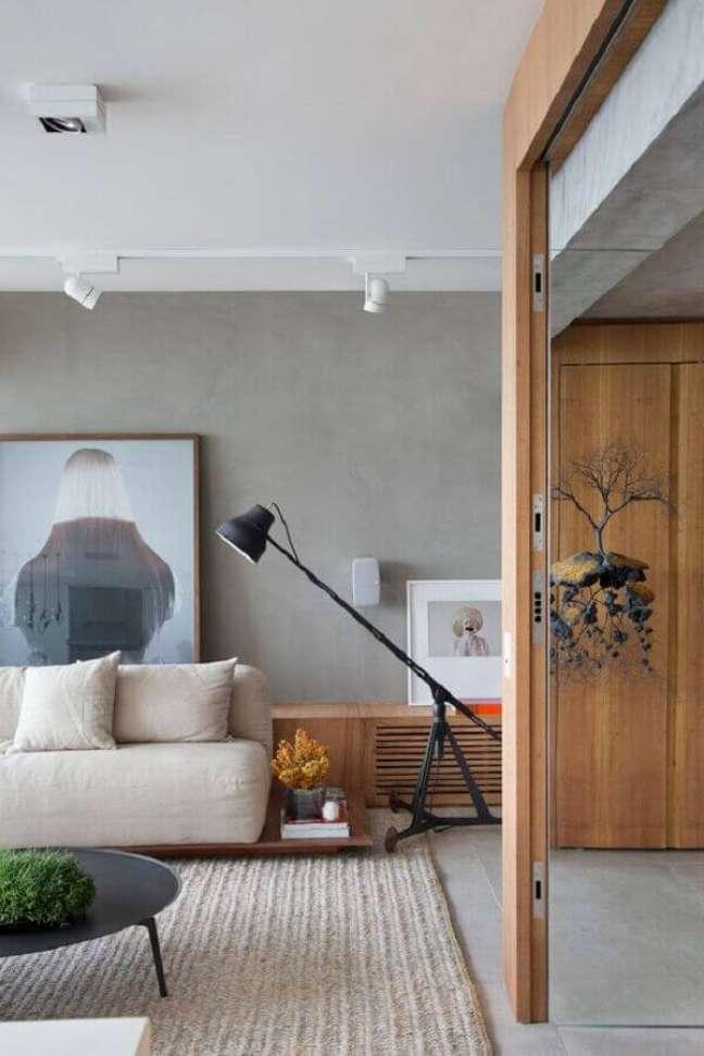 28. Luminária de chão moderna para sala de estar decorada com parede de cimento queimado – Foto Studio Roca