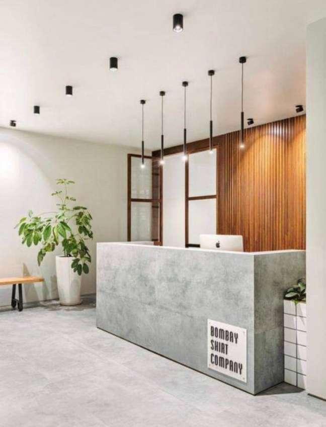 41. Sala de espera com balcão de cimento queimado moderno – Foto Etsy
