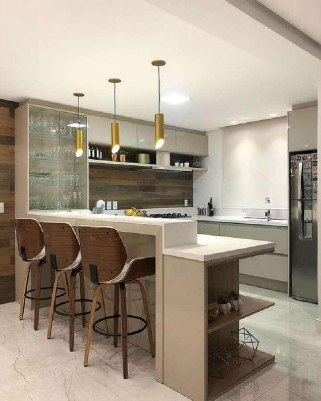 54. Estilo de cozinha americana decorada com cristaleira de parede – Foto: Decor Salteado