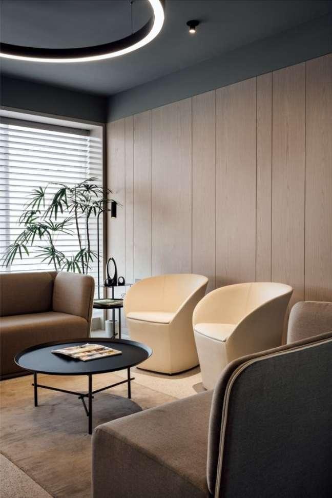 49. Sala de espera com móveis modernos e elegantes – Foto Office Sanpshotss