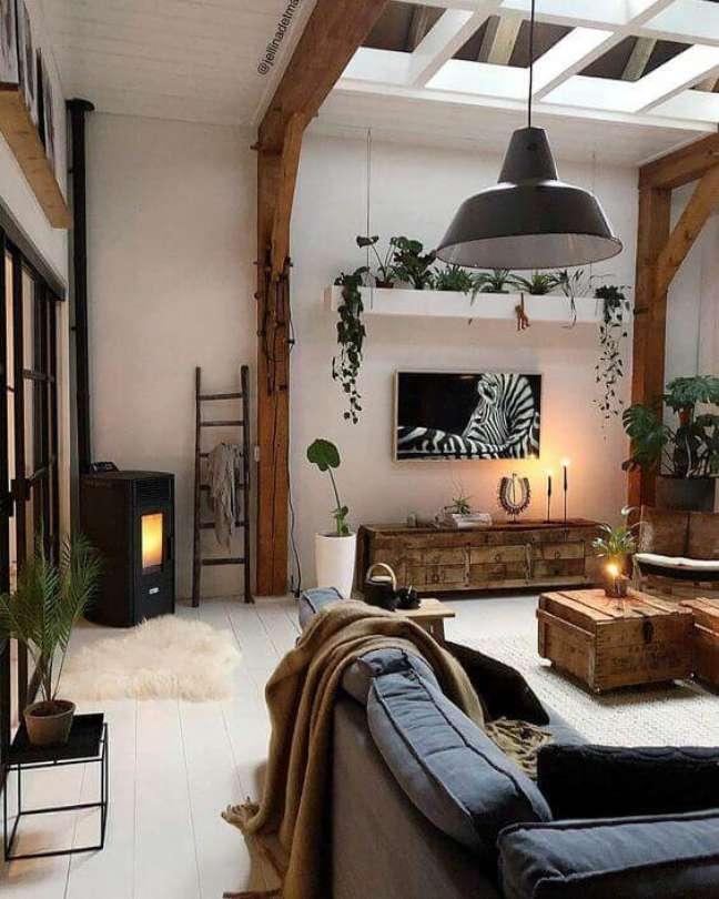40. Parede de sala decorada com móveis rústicos e estilo boho – Foto Webstagram