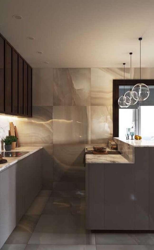 49. Decoração moderna em tons de cinza para cozinha estilo americana planejada com luminária de vidro – Foto: Apartment Therapy