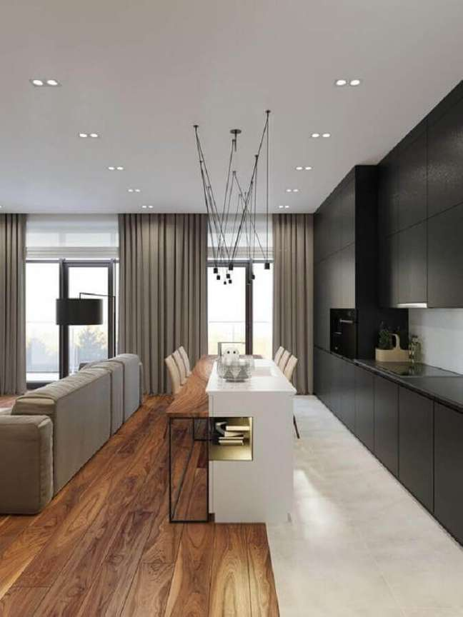 9. Estilo de cozinha americana com ilha decorada com armário preto planejado – Foto: Futurist Architecture