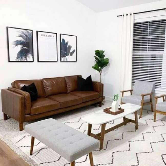 57. Parede de sala decorada com quadros preto e branco – Foto Pinterest