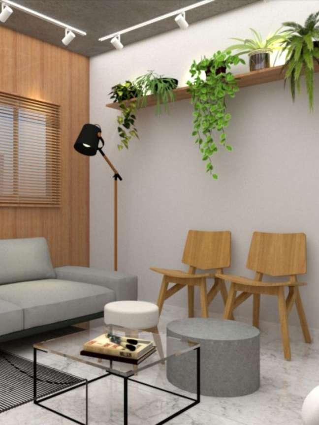 17. Sala de espera para escritório com cadeira de madeira e plantas – Foto Mora Estudio