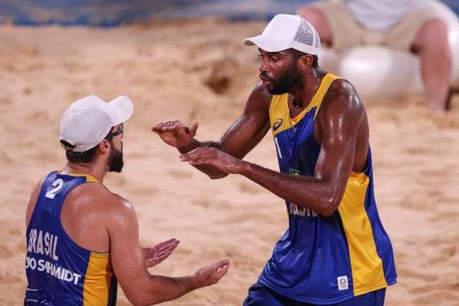Evandro e Bruno Schmidt avançaram em primeiro no grupo E (Foto: Divulgação/Wander Roberto/COB)