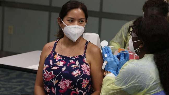 Woman being jabbed at Miami-Dade vaccine centre