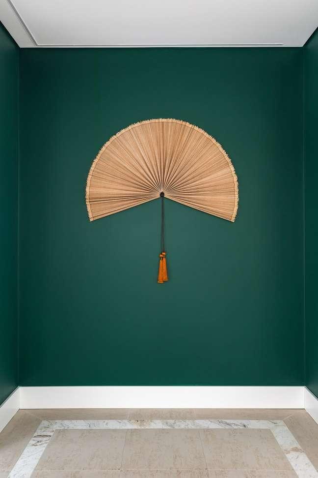 7. O hall verde transmite a sensação de aconchego e conforto. Foto: Eduardo Macarios