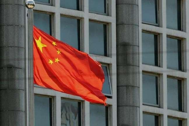 Bandeira da China não é única chinesa no pódio (Foto: STR / AFP / CP)