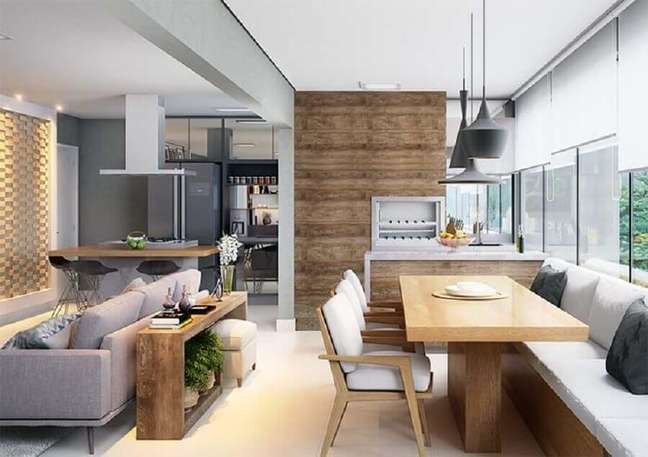 6. Decoração de varanda gourmet para apartamento pequeno com sala de estar integrada – Foto: Pinterest