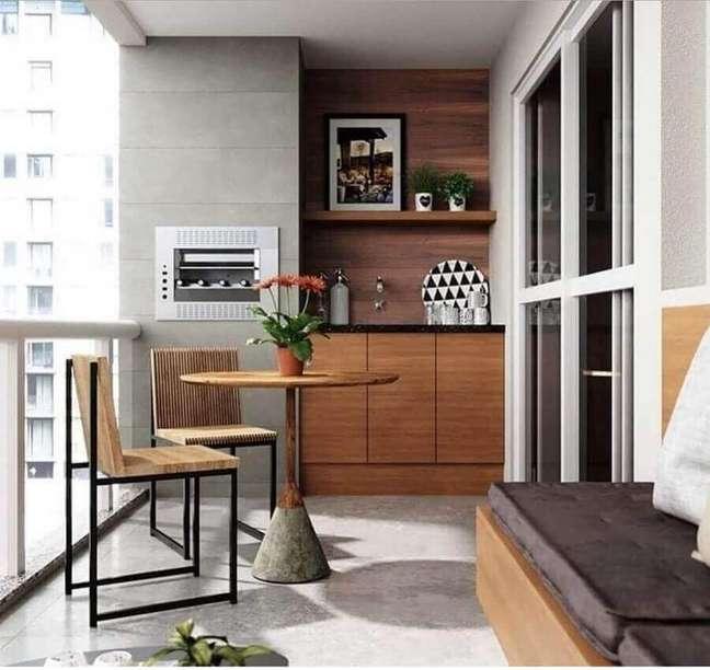 36. Decoração moderna para varanda gourmet para apartamento pequeno – Foto: Pinterest