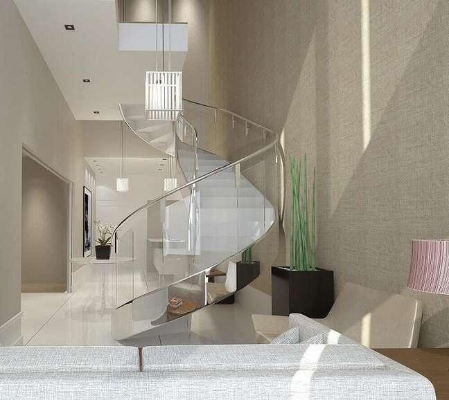 37. Lustre para escada caracol com design moderno e sofisticado. Fonte: Pinterest