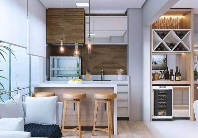 34. Decoração de varanda gourmet para apartamento com sala integrada – Foto: Pinterest