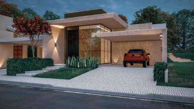 57. Casa com garagem coberta – Foto Cardoso Eder