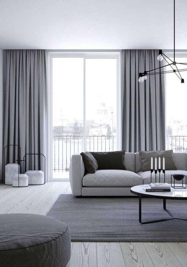 5. Sala cinza e branco minimalista decorada com lustre moderno – Foto: Futurist Architecture