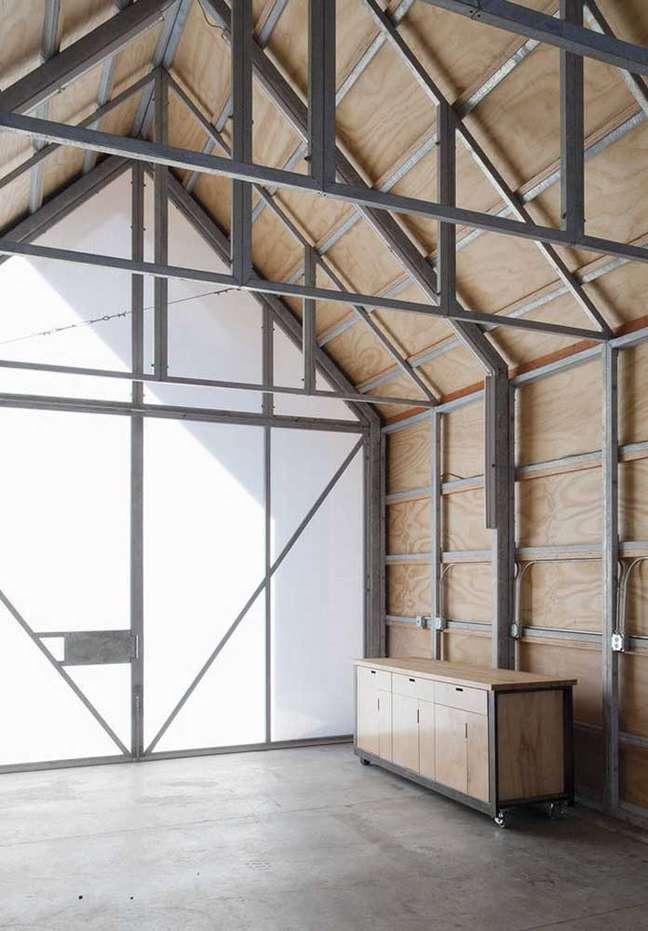 29. Cerâmica para garagem cinza queimado com móveis de madeira – Foto Pinterest