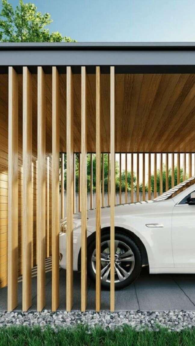 59. Modelo de garagem com teto de madeira e piso cerâmico – Foto Pinterest