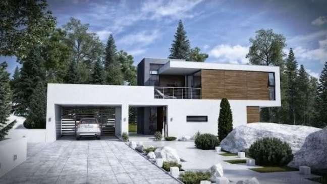13. Casa com cerâmica para garagem na entrada aberta – Foto Yukbiznis