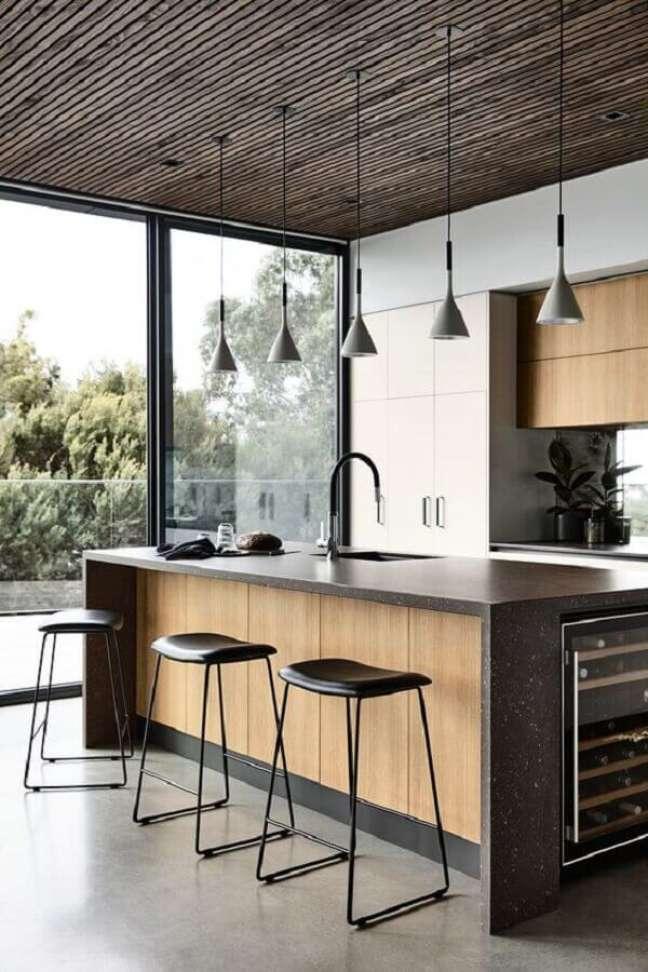 58. Decoração moderna com banquetas para ilha de cozinha planejada – Foto: Futurist Architecture
