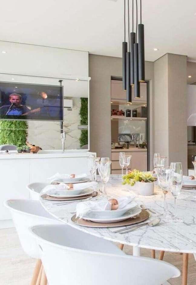 17. Decoração sofisticada com luminária para sala com mesa de jantar branca com tampo de granito – Foto Pinterest