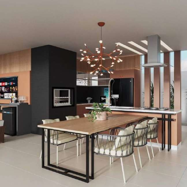 5. Decoração moderna com lustre para área gourmet planejada com detalhes sofisticados – Foto: Jeito de Casa