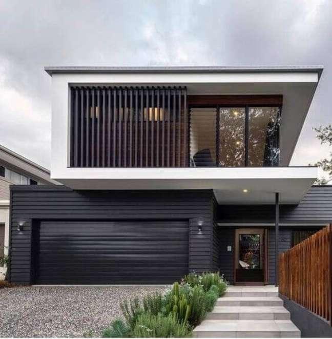 29. Cores para fachada de casa com portão de ferro preto e pintura branca – Foto Pinterest