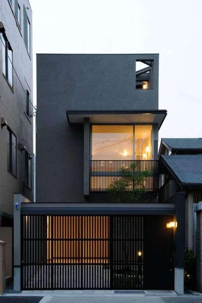 27. Cores para fachada de casas estilo industrial com portão de ferro – Foto Pinterest