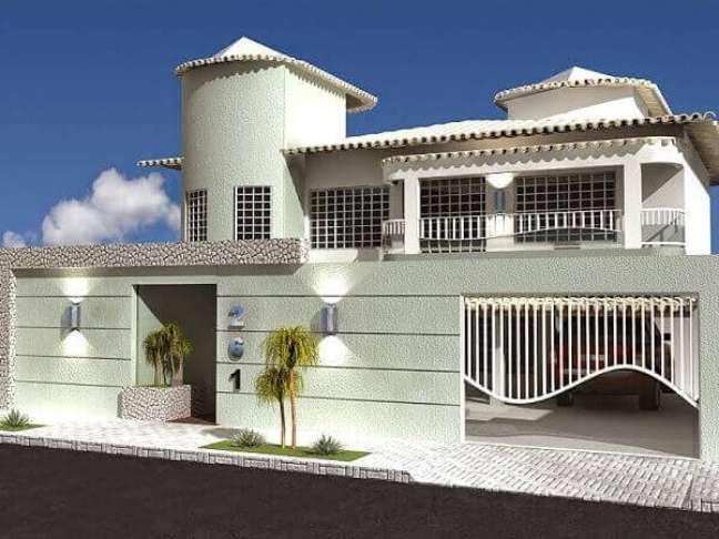 53. Decoração com cores para fachadas de casas modernas com portão branco – Foto Pinterest