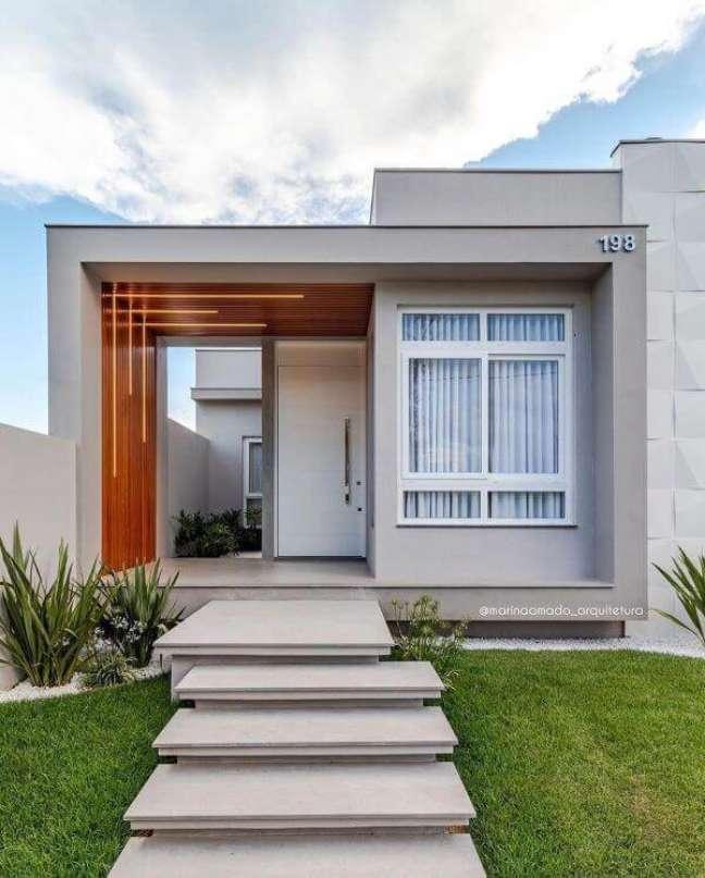 51. Decoração com cores para fachada de casa em tons de cinza e branco -Foto Pinterest