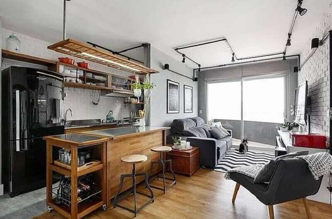 44. Decoração estilo industrial para cozinha aberta com sala de apartamento – Foto: 3P Studio
