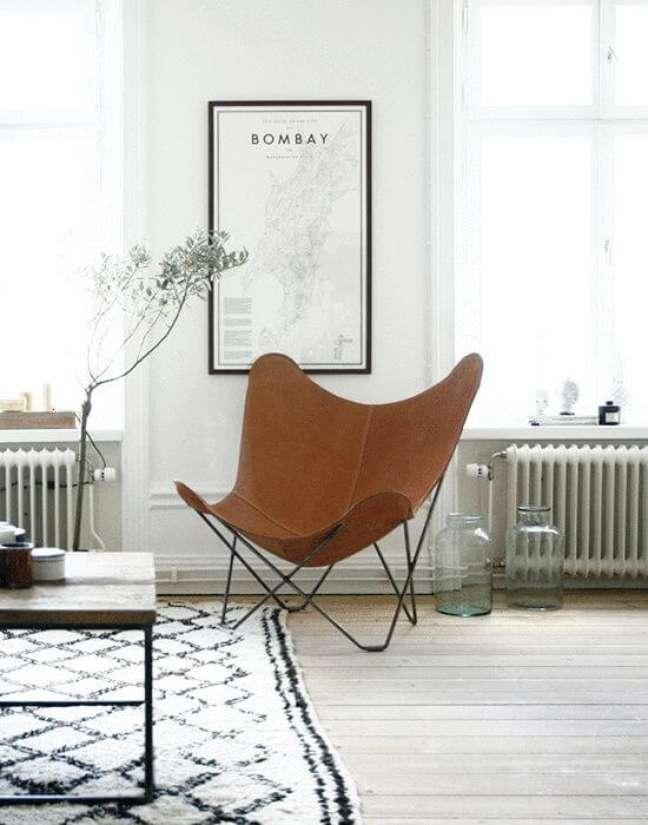 44. Decoração minimalista com poltrona butterfly – Foto Artilleriet Interiors