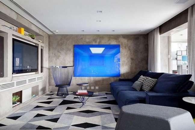 63. Tipos de sofás retrátil para decoração de sala de TV moderna com parede de cimento queimado – Foto: Suíte Arquitetos