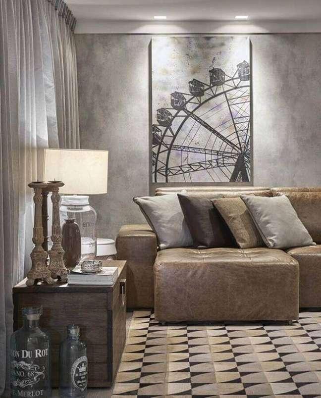24. Tipos de sofá de couro retrátil para decoração de sala com parede de cimento queimado – Foto: Líder Interiores