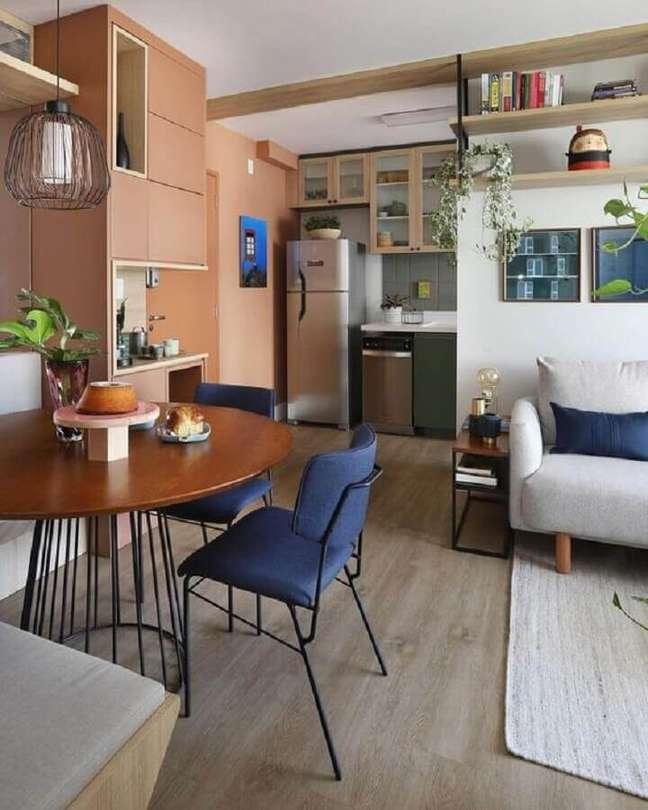 15. Decoração com mesa redonda para sala de jantar e estar integradas – Foto: Mandril Arquitetura